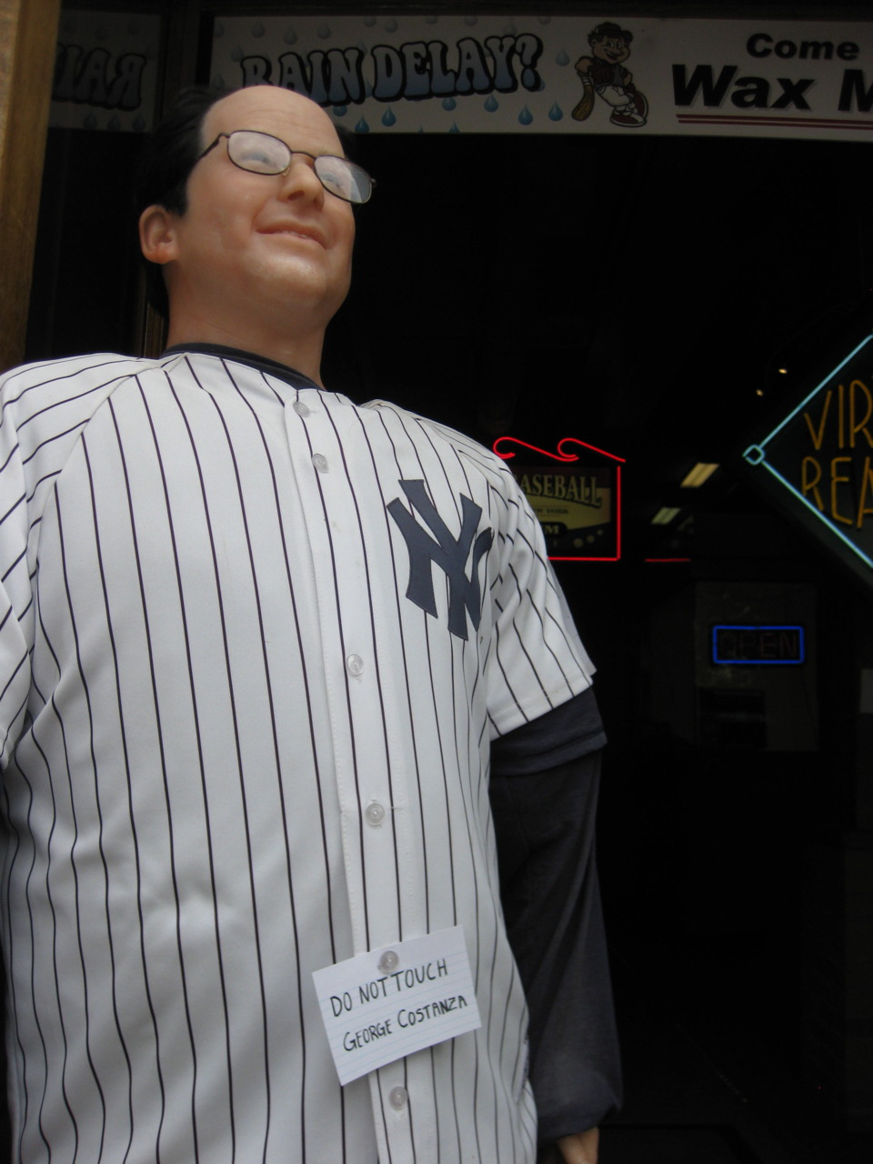 """Outside of the Heroes of Baseball Wax Museum, Cooperstown, NY. As a baseball agnostic from Massachusetts, this town was like a nightmare.   Stu put it very succinctly, when it comes to baseball fandom these days: """"It's like saying I'm a big fan of this corporation, headquartered here."""" When I wrote a bunch of articles for a Boston paper, often the subjects would try to endear themselves by talking about the Red Sox, which I… frankly, couldn't relate to much. And yet I still laughed at Marky Mark shooting Jeter in the leg in The Other Guys. Baseball + regional identity = so complex!"""