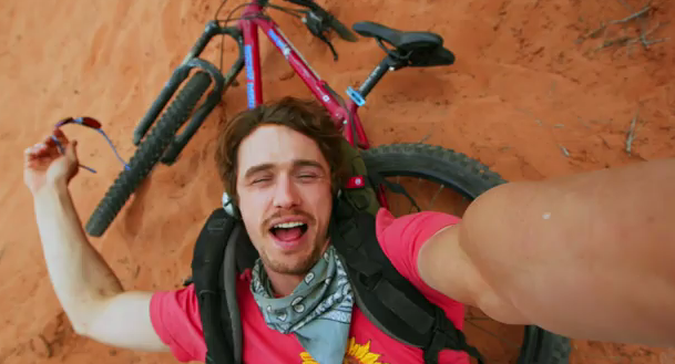 127 Hours is a great movie   and I really enjoyed it. It is also a referendum on the variety of faces James Franco can make. I now feel like I've slept with him and I have no need to find him attractive anymore. He was, arguably, at his most chisled/dangerous/dreamy as Daniel Desario in Freaks and Geeks, I think.  I specifically asked to talk with screenwriter Simon Beaufoy about working on the film; he's lovely and humble and let me talk his ear off about the nuances of structure in screenwriting. What they pull off is practically experimental, and the rumors of faintings (and I get it) are really interesting - horror films are more gory than this, but in 127 Hours, you feel the gore and it has human consequences. You feel it in the audience in a way you wouldn't otherwise. So go see this film in the theater!