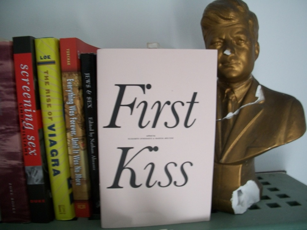 """My copy of First Kiss finally came in the mail! I placed it in a spot of honor on our """"academic sexuality"""" shelf, in between """"Jews & Sex"""" and getting a buss from a bust of your favorite Irish Catholic president.  The zine is a great read and made me laugh out loud a bunch, but I gotta say I think Ashley Merriman's writing about the last first kiss was utter truth and it made me swoon."""