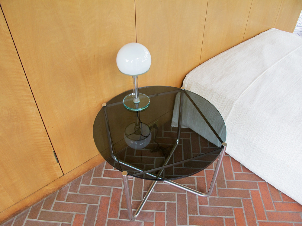 Bedroom:  Wilhelm Wagenfeld and Carl Jacob Jucker Bauhaus lamp, 1924; Ludwig Mies van der Rohe Low table, 1927