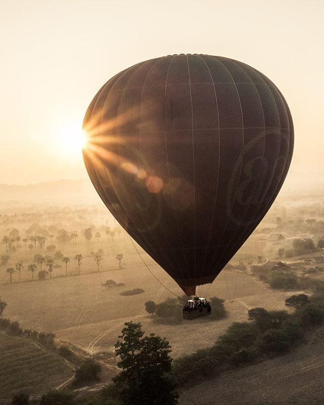 A hot air ballon floats over the magical region of Bagan, Myanmar. Over 2,200 temples stand in the area, with only countryside between them; the wooden city that used to reside here is long gone, leaving only its numerous sites of worship. #myanmar #burma #bagan #travel #bbctravel #lonelyplanettraveller #hotairballoon #southeastasia #travelgram #trveller #travel #backpacking #landscape #temple #sunrise