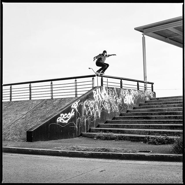 Victor Arias. Back royale drop back royale while raining. This photograph is featured in Volume 01, unfortunately since it was raining and starting to become dim, I was not able to shoot it on 16mm so instead it was shot digitally. The maneuver itself was featured in The VA.1 Valo skate section. (Probably for the best it was shot digitally because it took a long time) in some ways that's the nice part about shooting on film, it's own limitations of having only so much physical feet of film, making it a bit of a higher pressure scenario both for the skater and myself. Full commitment, every time. www.hermanos.film photograph @brandonsmith8