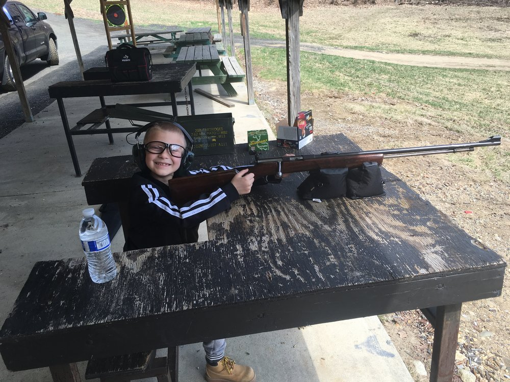 Hayden gloss enjoying time with his dad on our rifle range