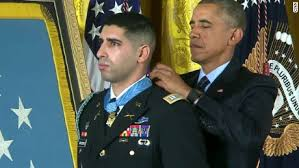President obama presenting the medal of honor.