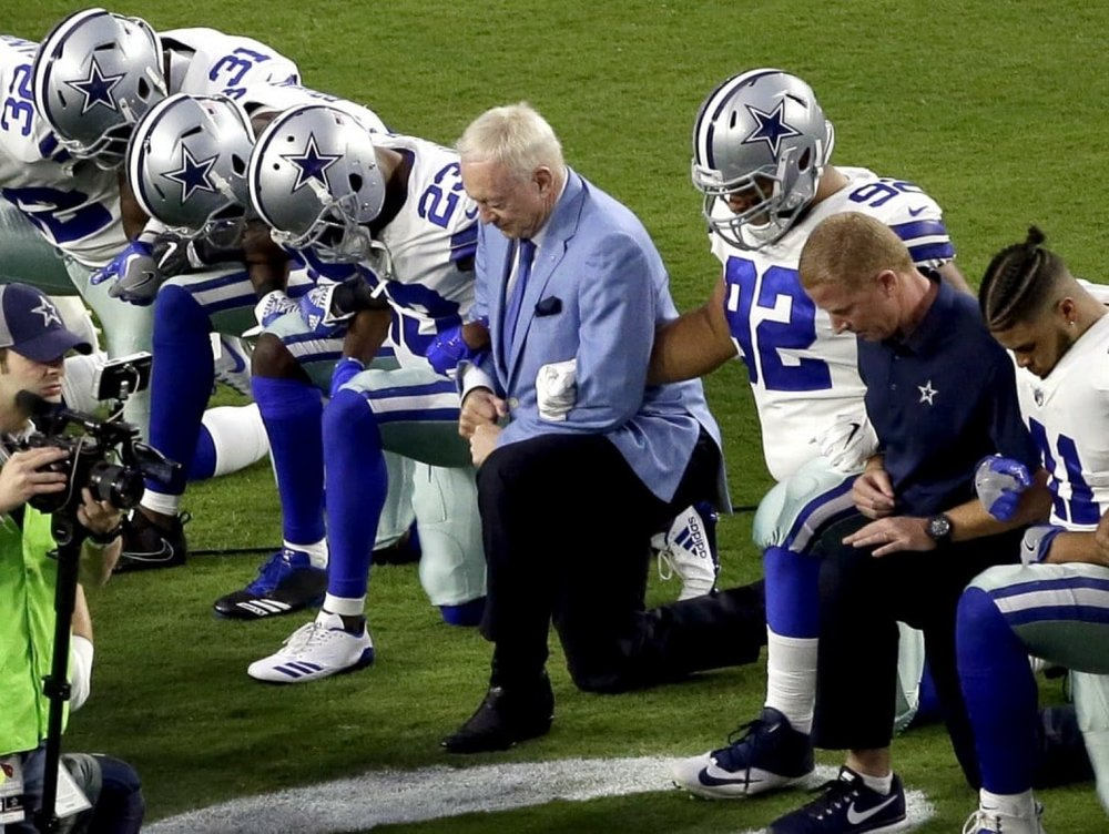 Jerry Jones, owner of the dallas cowboys, kneels with team pre-national anthem.