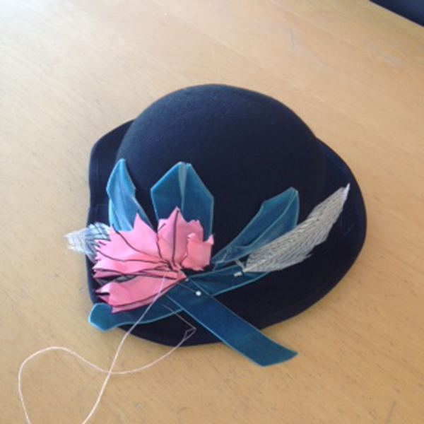 Trimming my hat with Ribbon and Feathers