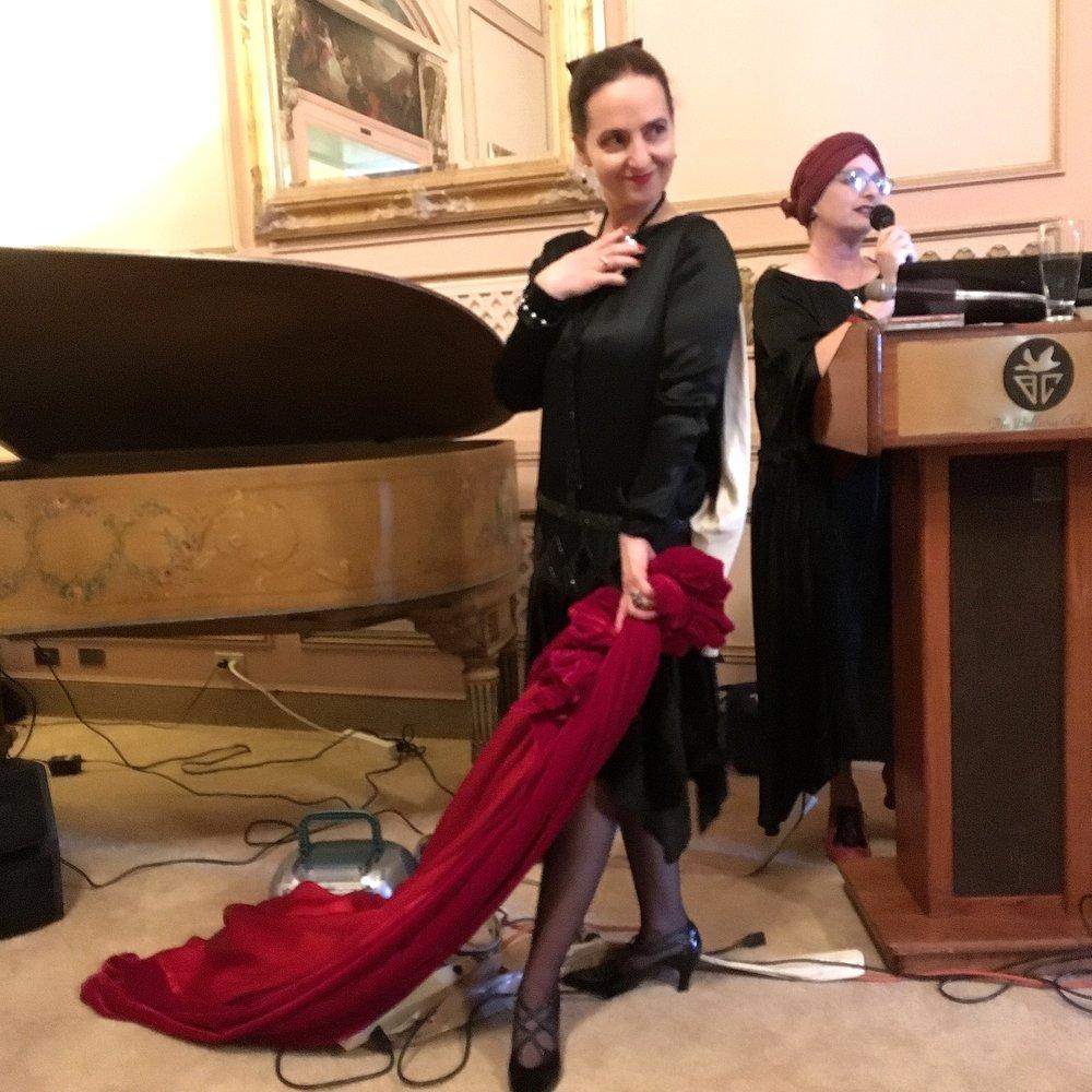 Chocolatiere Leah Vass  and her Vampy red velvet cape & 1920's black evening frock