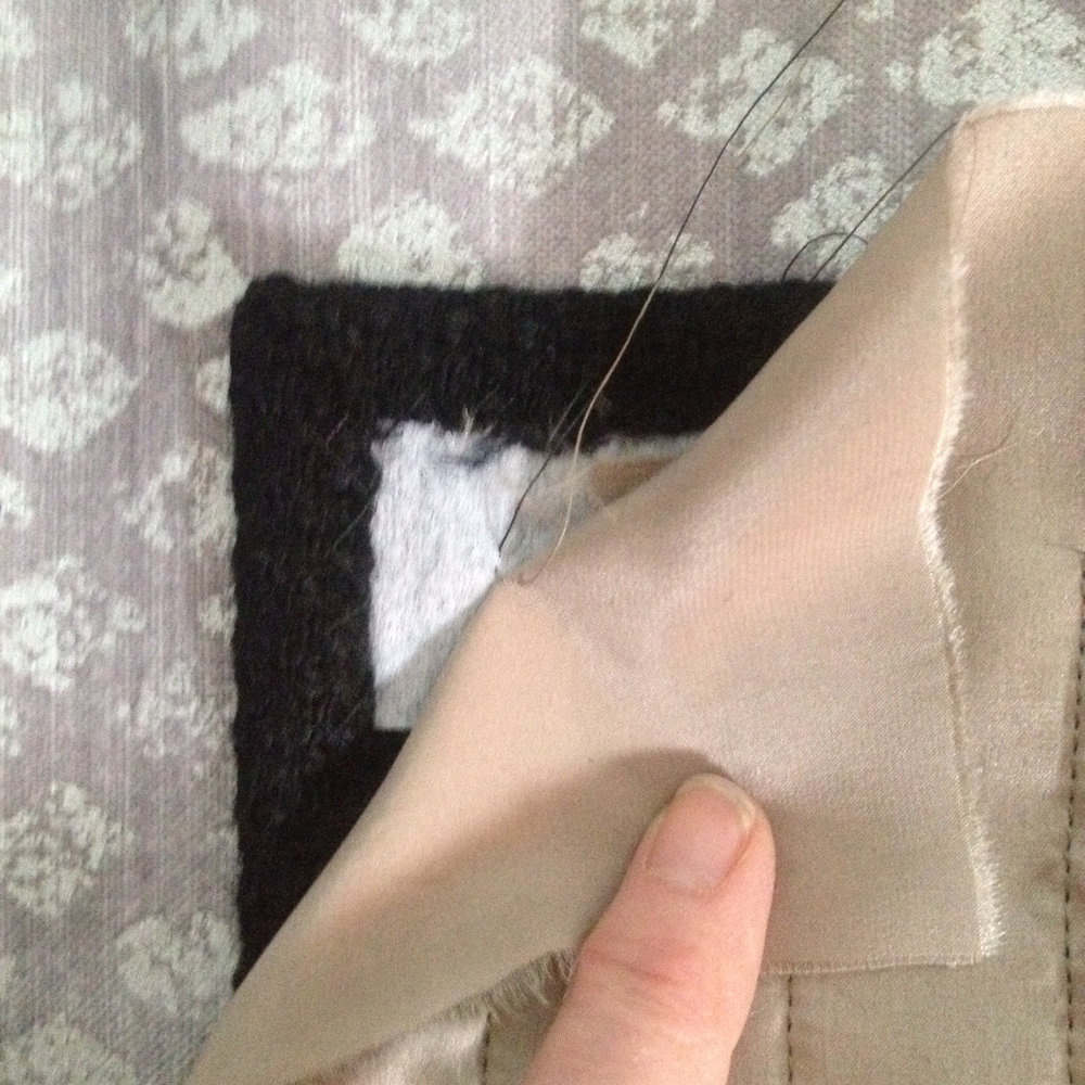 6.  Pull thread ends to inside between lining and pocket.