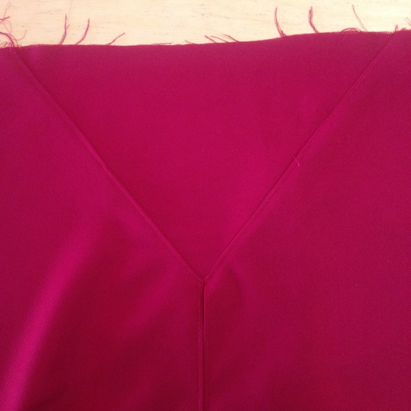 "I pressed the seam allowance towards the skirt (away from v-insert) and top stitched on the skirt side, 1/8"" from seam."