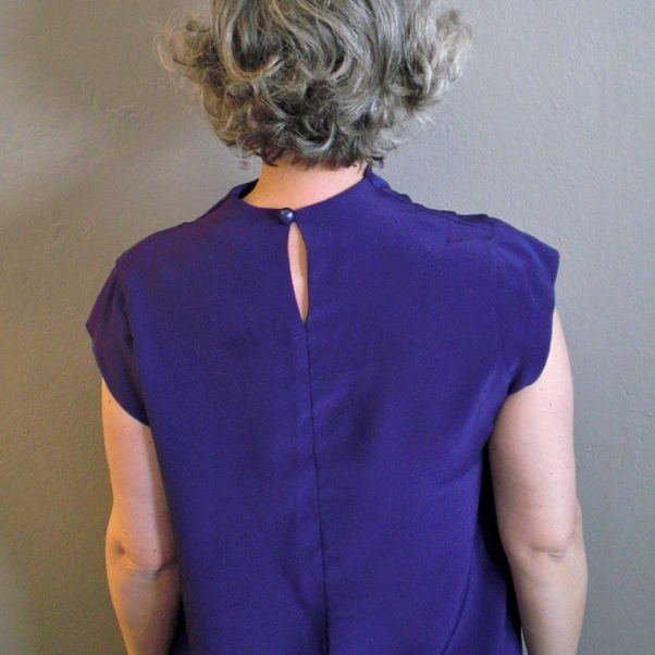 It's hard to see but the the back feels tight, midway down the armhole.
