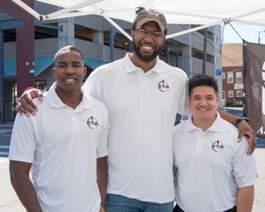 Dj Haley (middle), co-founder and former VCU teammate Rob Brandenberg (left), and ETA:Give Director of Marketing Jeremy Senseng (right)