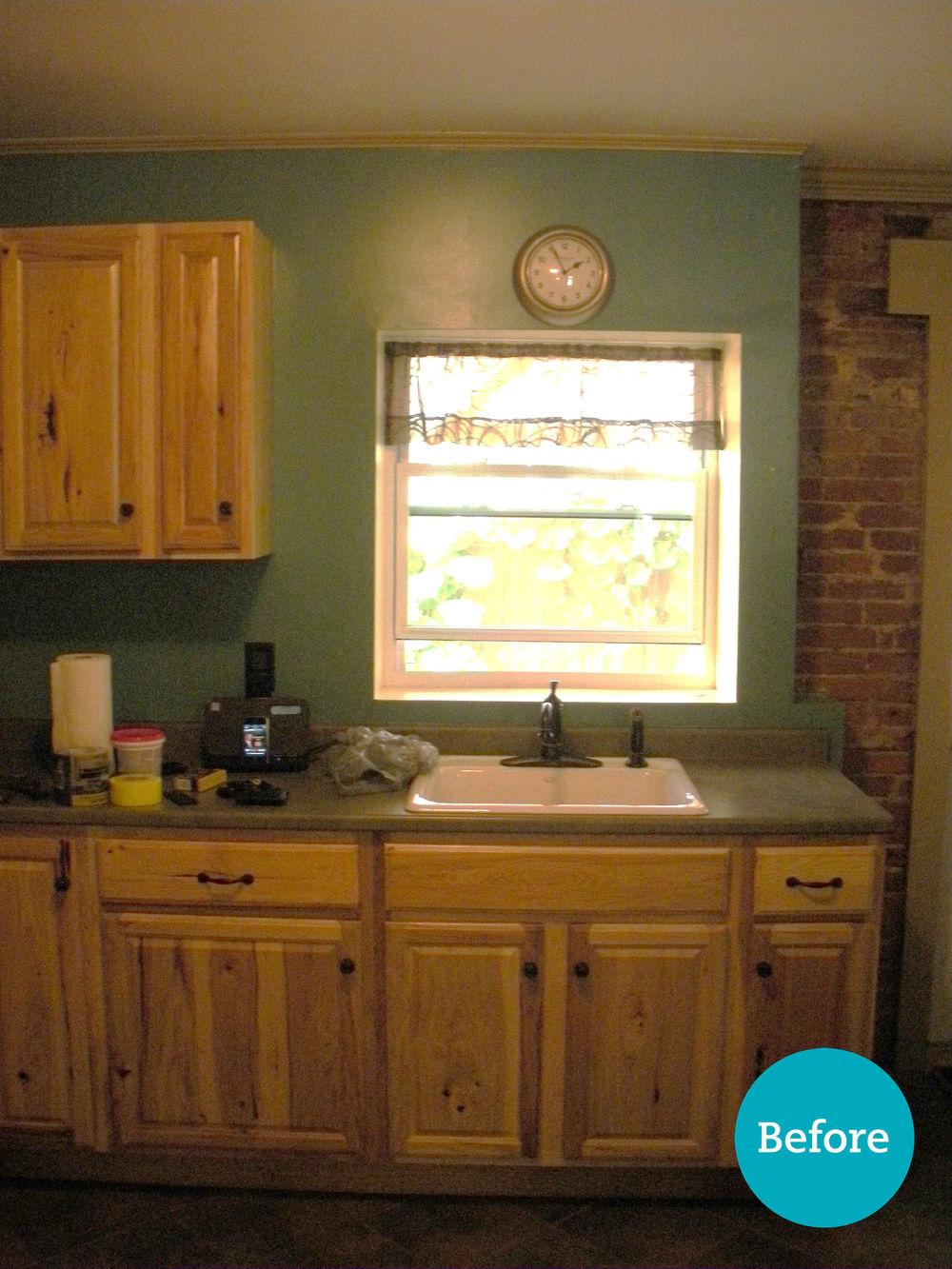 Dark, traditional style kitchen.