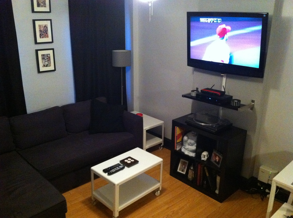 Entertainment center with wall-mounted TV.