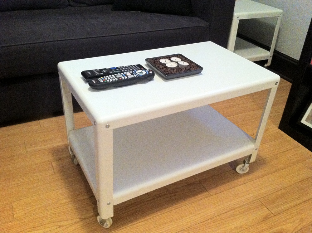 Cart on wheels is a coffee table, an extra one in the corner is back-up for larger parties.