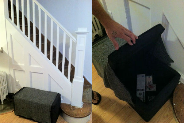 Two ottomans are placed next to the stairs for seating and storage of living room items.