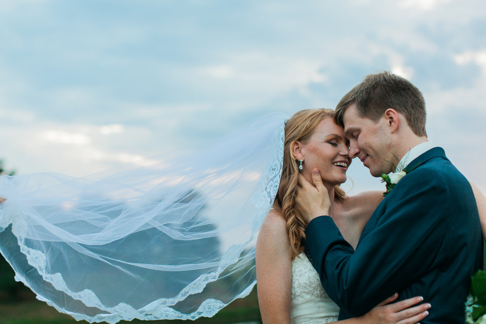 happy couple athens wedding field valley barn sunset