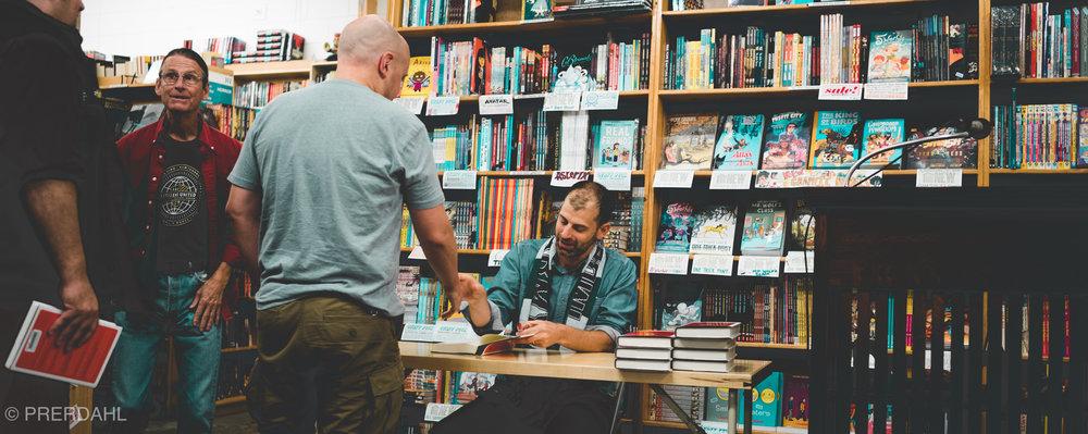 ken bensinger signing books.JPG