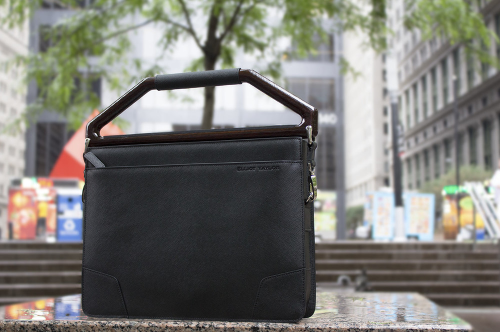 Elliot Taylor NY - Fit into the urban landscape and connect to natural elements with our leather and wood combination.  Briefcases for Distinct Gentlemen.