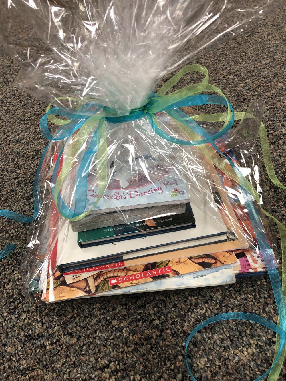 Young Readers Basket   Contains a stack of great books! Pirates Night Before Christmas, Kitty in Boots, Little Polar Bear Finds a Friend, Anna & Elsa, Enemy Pie, True Story of the 3 Little Pigs, Amelia Bedelia and Palace Pets