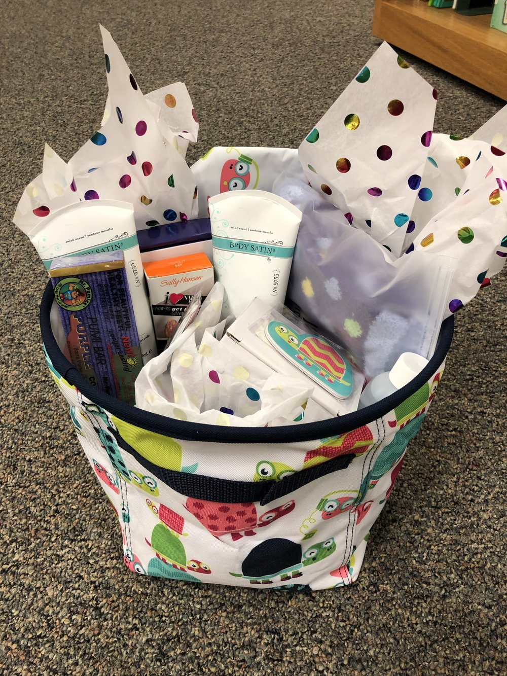 Spa Day   Pamper even the littlest toes with this basket of lotions, polishes and cozy spa socks.