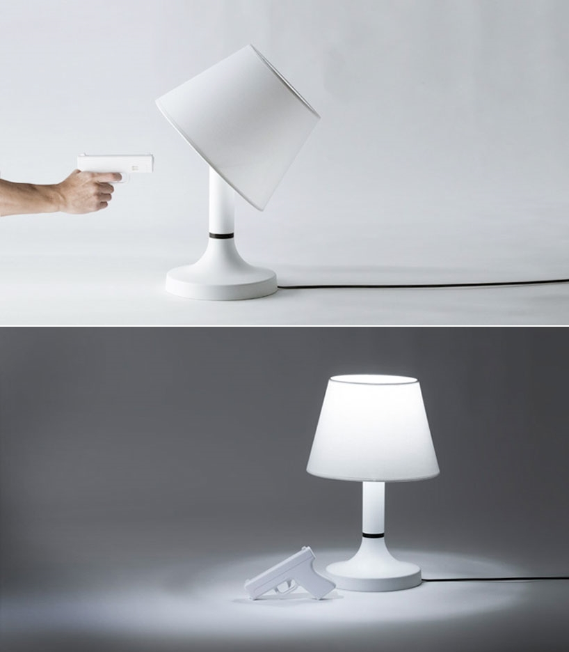 """thedailywhat: Lamp Design Concept of the Day: """"Bang! Lights Out!"""" from Japanese design studio bitplay INC. (AKA Jack Chang and Josh Cheng) gamifies the traditional desk lamp by adding a gun-shaped remote than not only turns the light off, but also causes the lampshade to tilt as if hit. """"Bang!"""" was unveiled, along with its siblings """"Puzzle"""" and """"Tiktiktik,"""" at the annual Tokyo Designers Week. [designboom.]"""