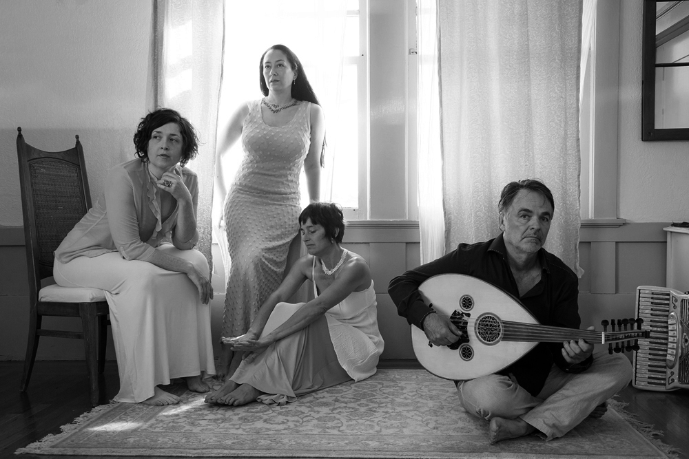Photo by Anastasia Kuba. True Life Trio is: Leslie Bonnett: voice, fiddle, percussion; Briget Boyle: voice, guitar, percussion; Juliana Graffagna: voice, accordion, percussion; Gari Hegedus: tarhu, mandocello, pontic lyra, and oud.