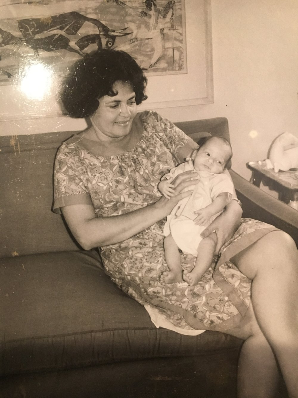 Mom holding infant Roger at home, 1962