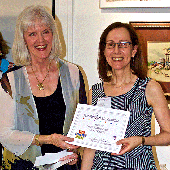 Linda McCarley, Vice President of Plano Art Association presenting Nanc with a Merit award.