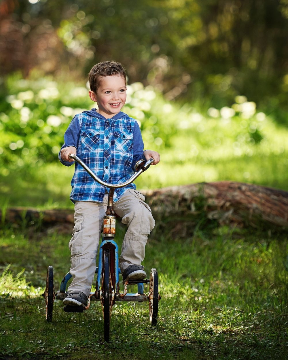 Professional outdoor photo of boy on bike