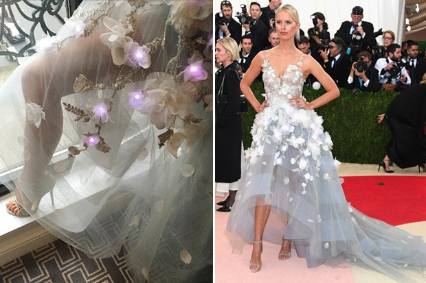 "Dubbed ""The Cognitive Dress"": White tulle design embroidered with 150 LED-connected flowers that were programmed to light up based on varied ""emotion-based"" social media reactions. Say whhaaa?"