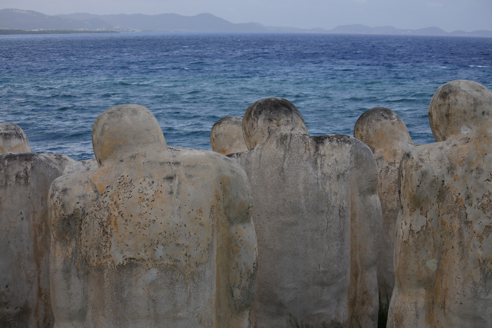 The statues all look towards the sea that took their lives.
