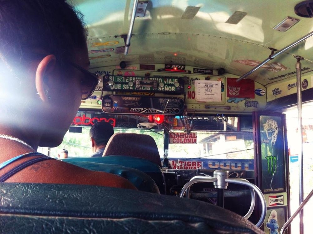 3. Sitting on the foursome seat in the Salvadoran chicken bus, as taken by my friend Anne, 2015