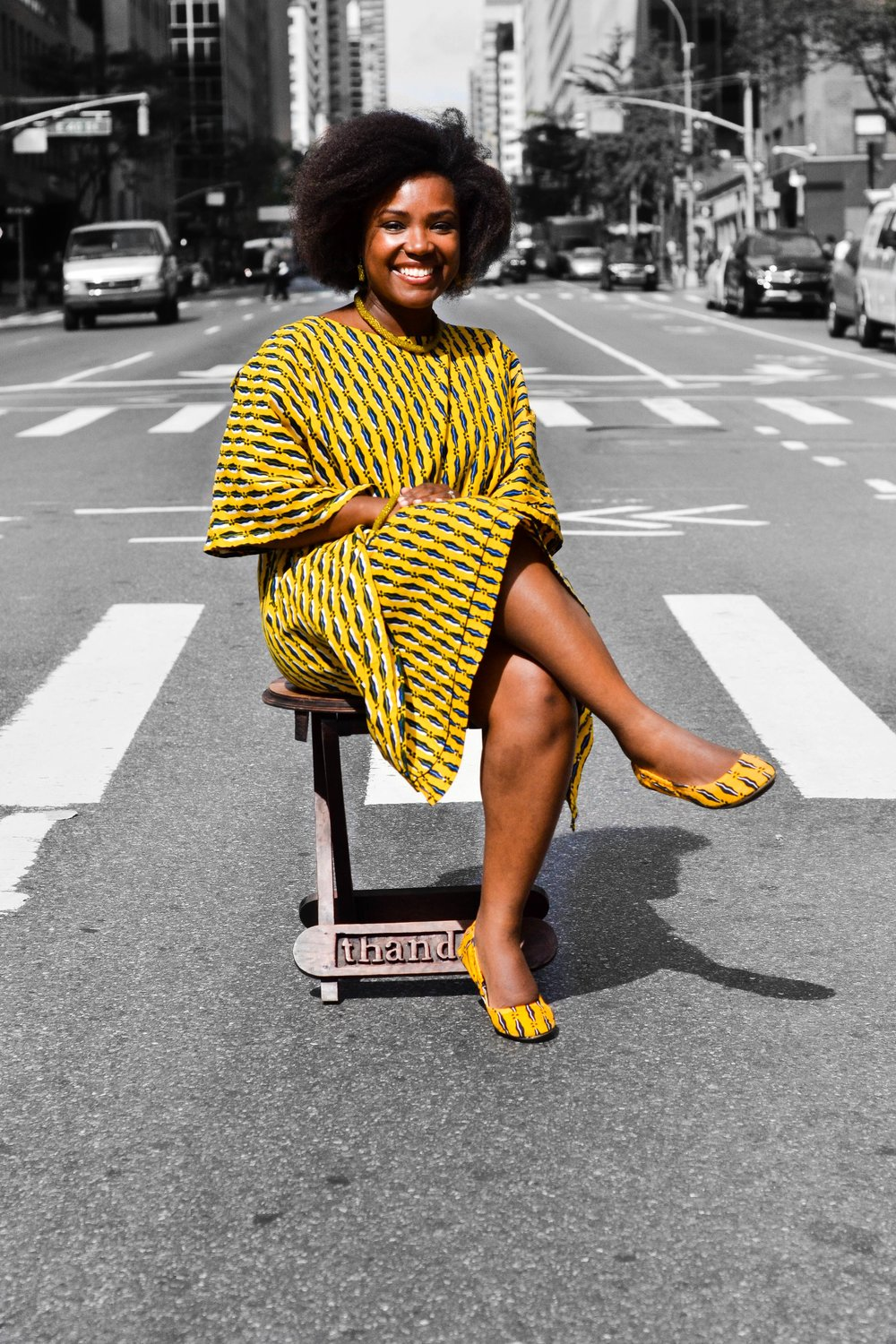 Co-founder Taffi Ayodele donning a pair of 'First Kiss' Thando's flats. This design was the first of their collection.