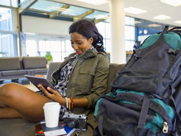 best-airports-for-layover-woman-waiting-for-flight.jpg.rend.tccom.616.462.jpeg