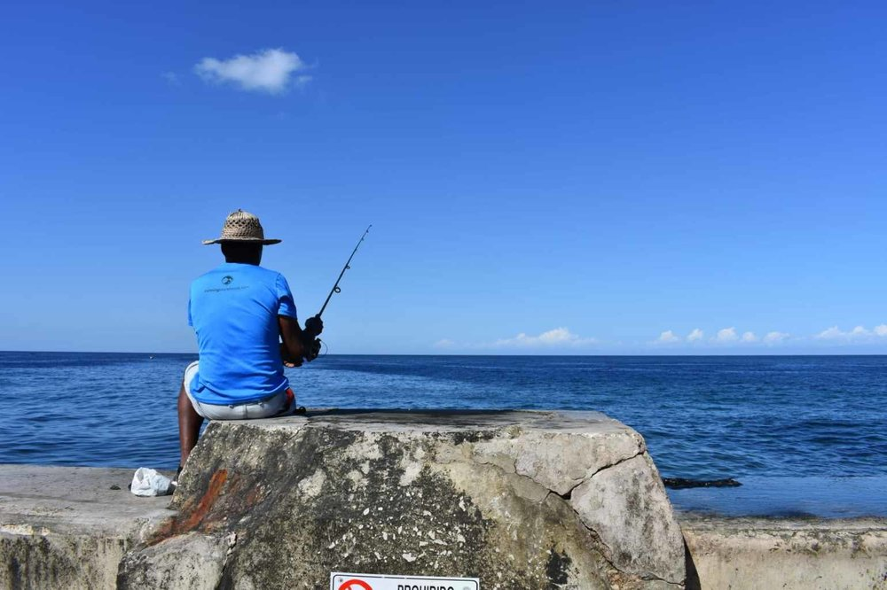 A fisherman on El Malecon in Havana, Cuba looking for his next catch