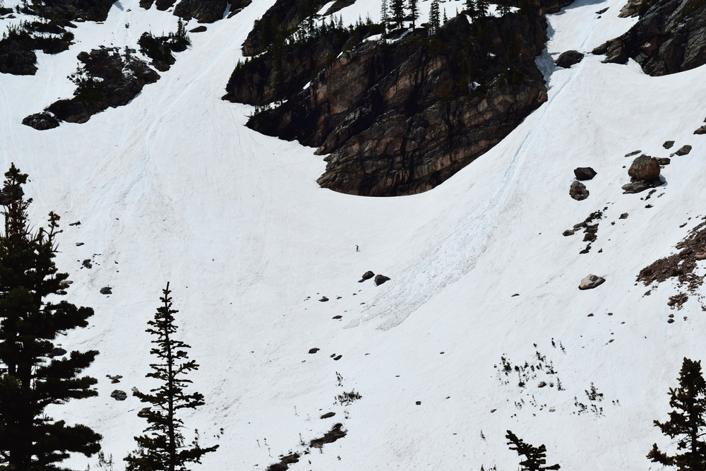 The dot in the middle there is a backcountry skier with his skis strapped to his back