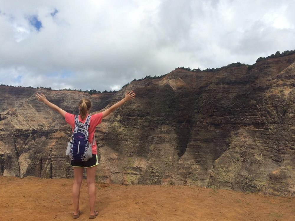 My sister, Olivia, with her pack in Waimea Canyon, Hawaii.