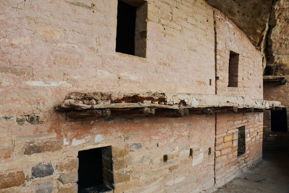 """The ledge you see is actually why this is called """"Balcony House."""" These balconies provided quick access from one upper level to the next (there were no ladders inside these buildings, just a floor/ceiling dividing the two levels) and are still structurally sound enough to hold people - almost 900 years later!"""