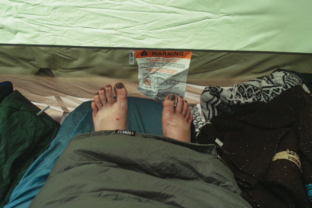 Pardon my gross camp feet, but LOOK I can be snuggled inside AND have my feet out for optimal temperature control!