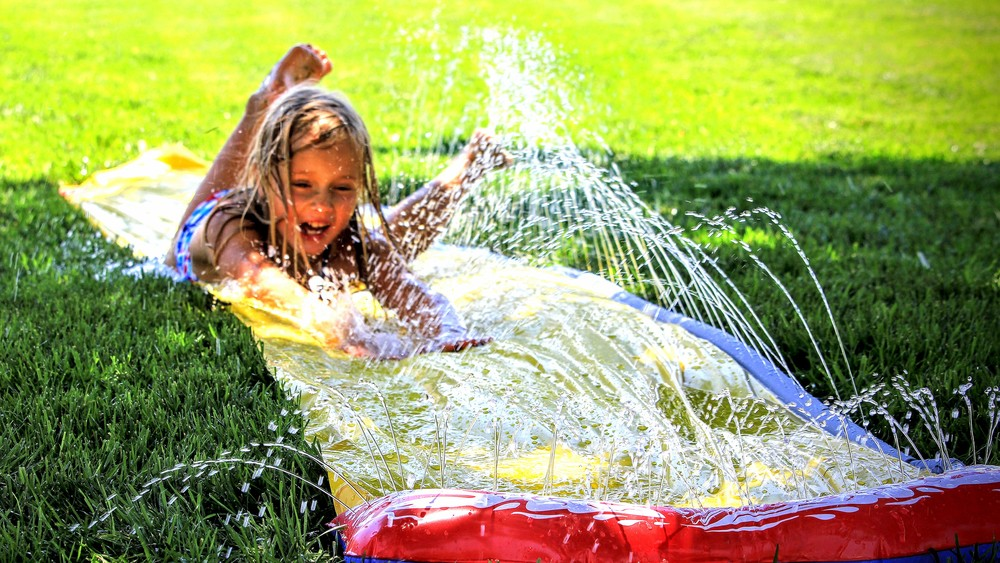 My super-awesome, fun, creative, talented niece enjoying a little summer slip-n-slide. She's going places.