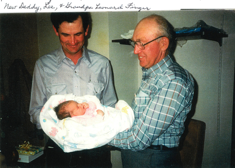 Baby Ann with daddy Lee and Grandpa Finger