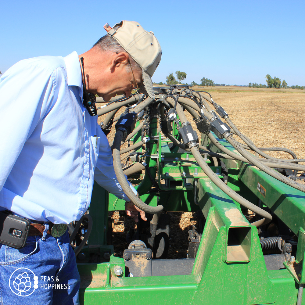 Dad (Lee) explains how the air seeder works - using air pressure to push a wheat kernel underground, followed by a heavy disc that cuts through last season's residue to place dry fertilizer under the ground next to the seed
