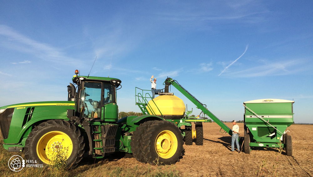 Dad and Vince loading fertilizer into the hopper of the air seeder