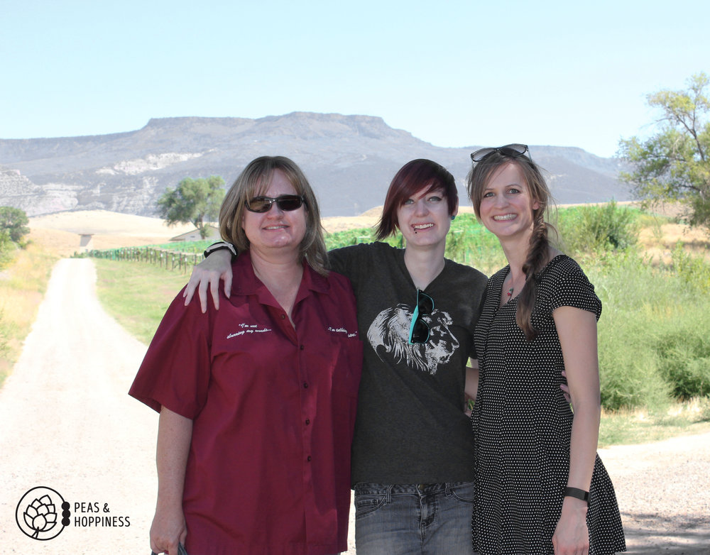 Lanette, Leanna, and me - with the grapes behind us and the mesa in the background.