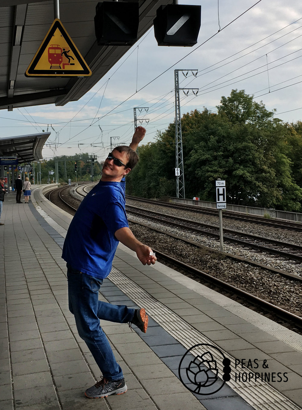 Caution: Do not fall onto the tracks! (Also note the German in a dirndl in the background - this was on our way to Oktoberfest!)