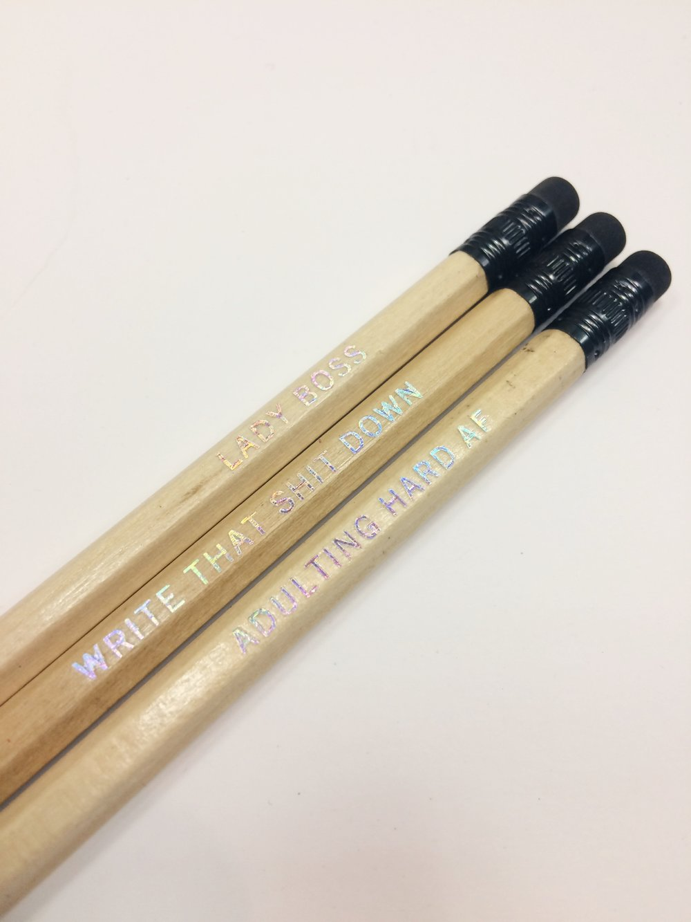 """LADY BOSS"", ""WRITE THAT SHIT DOWN"", & ""ADULTING HARD AF"" holographic letterpress pencils, $2 each"