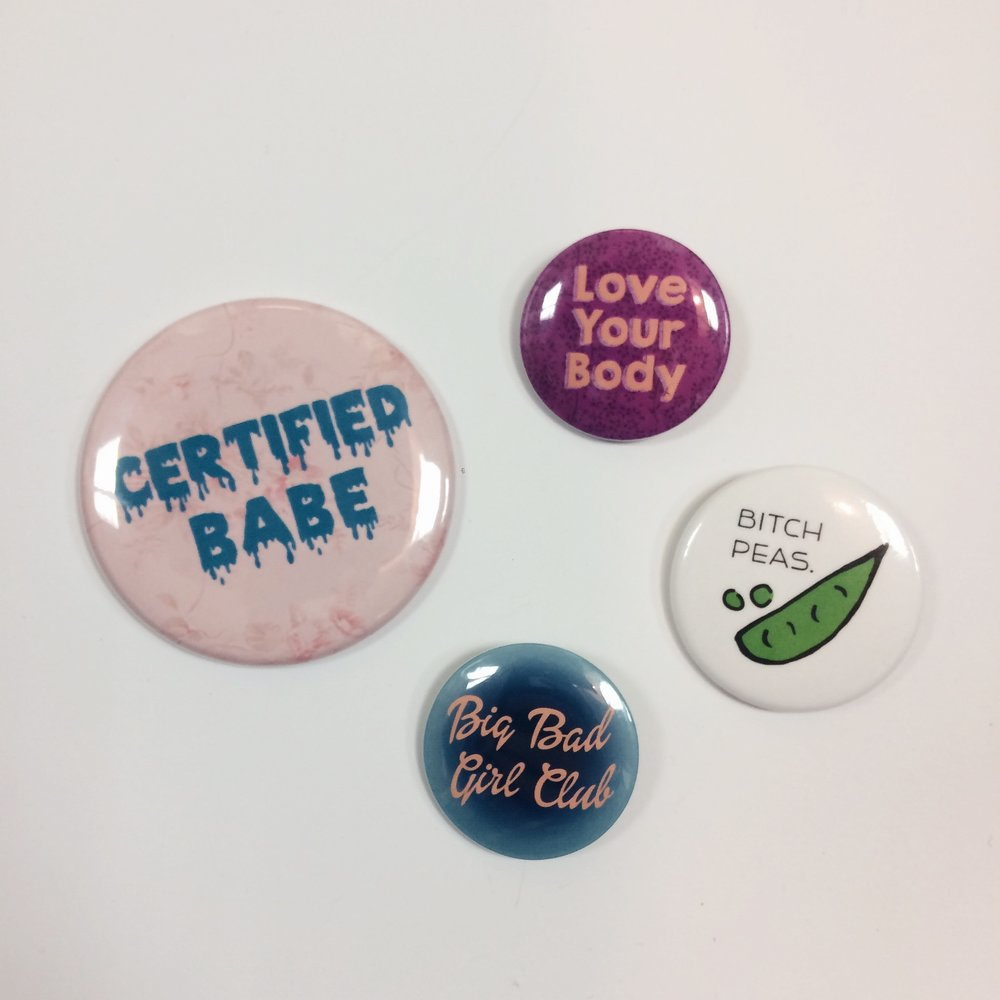 """Certified Babe"" pocket mirror, $5 ""Love Your Body"", ""Bitch Peas"", & ""Big Bad Girl Club"" pins, $2 each"