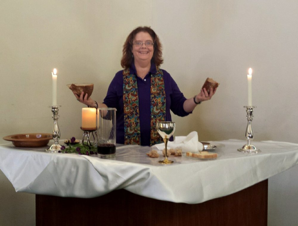 Reverend Jeanne giving communion