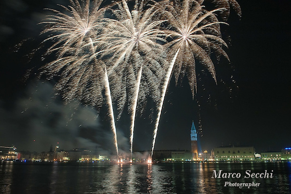 VENICE, ITALY - DECEMBER 31:   Fireworks display are seen in St. Mark's Square from S Giorgio during New Year's Eve street party on December 31, 2011 in Venice, Italy.  Official figures say that around seventy thousand people gathered in St. Mark Square for this year's street celebrations. (Marco Secchi)