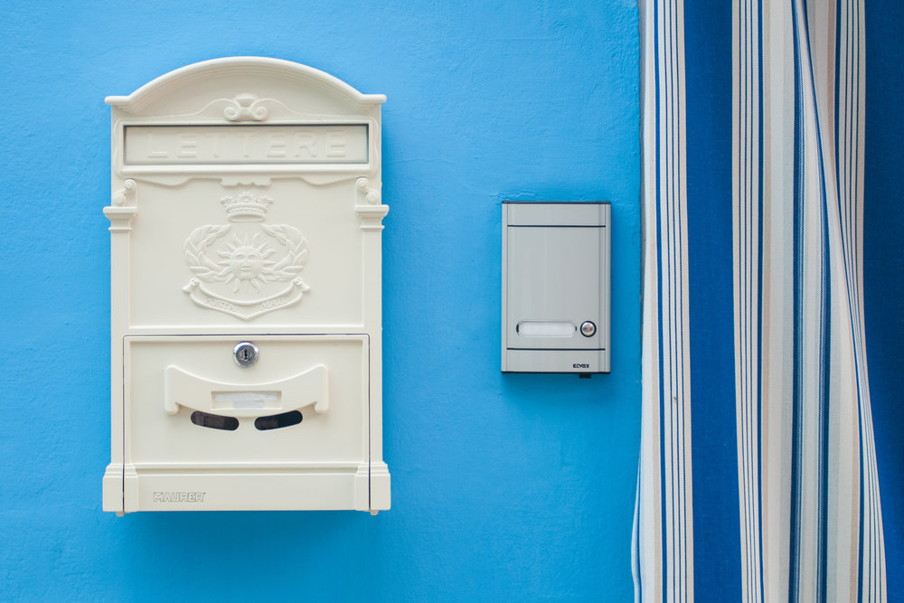 A mailbox and a doorbell in Burano, Venice, Italy.